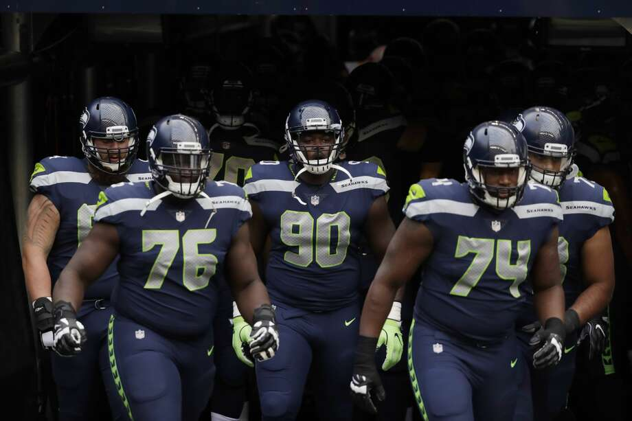 Seattle Seahawks' Germain Ifedi (76), Jarran Reed (90), and George Fant (74) take the field for warmups before an NFL football preseason game against the Minnesota Vikings, Friday, Aug. 18, 2017, in Seattle. (AP Photo/Stephen Brashear) Photo: Stephen Brashear/AP