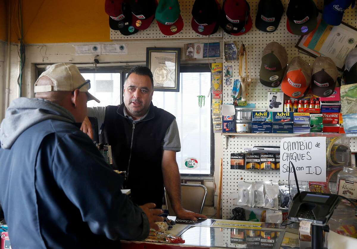 Rafael Casillas (right) chats with a customer inside the Beacon gas station he owns and operates at the intersection of Highway 68 and Hitchcock Road near Salinas, Calif. on Friday, Aug. 18, 2017. The crossroads was once known as Confederate Corners where farmers with Southern sympathies used to gather.