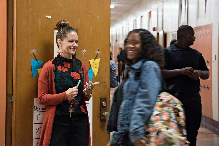 Danielle Battee (left), who taught English last year at Wallenberg High in S.F., greets her students as they arrive at her new L.A. school. Photo: MELISSA LYTTLE, Special To The Chronicle