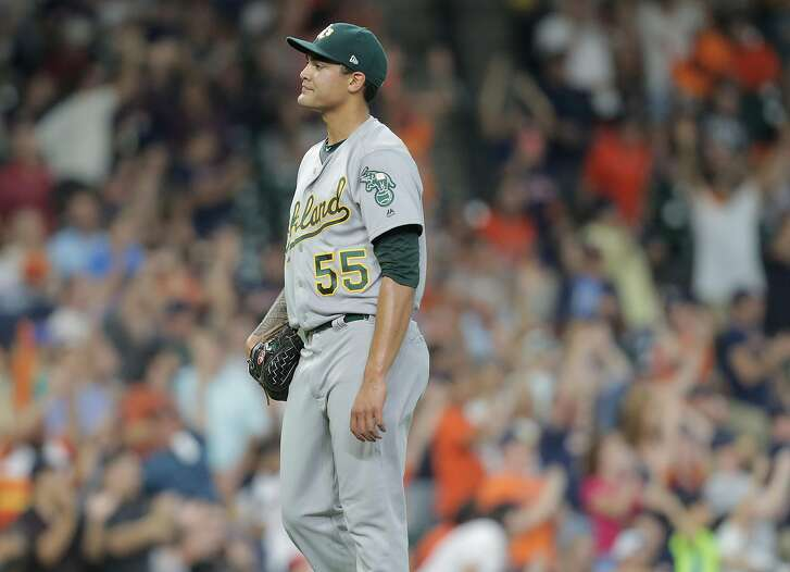 Oakland Athletics starting pitcher Sean Manaea (55) reacts as Houston Astros second baseman Jose Altuve (27) rounds the bases after back-to-back home runs in the third inning. Houston Astros host the Oakland Athletics at Minute Maid Park on  Friday, Aug. 18, 2017, in Houston. ( Elizabeth Conley / Houston Chronicle )
