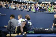 Seahawks tackle George Fant is carted off the field after suffering a leg injury in the first half of Seattle's preseason matchup with the Minnesota Vikings at CenturyLink Field on Aug. 18, 2017.