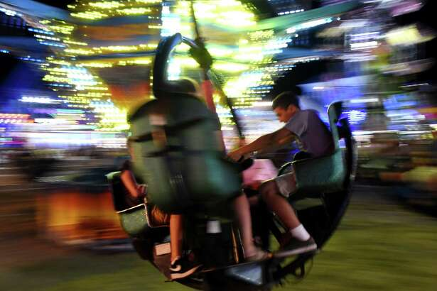 The Tornado thrills riders at the Altamont Fair on Thursday night, Aug. 17, 2017, in Altamont, N.Y. (Will Waldron/Times Union)
