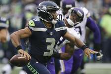 Seattle Seahawks quarterback Russell Wilson looks for a receiver, during the first half against the Minnesota Vikings in an NFL football preseason game, Friday, Aug. 18, 2017, in Seattle. (AP Photo/Scott Eklund)