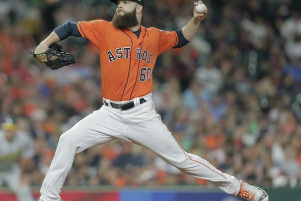 Houston Astros starting pitcher Dallas Keuchel (60) pitches in the top of the seventh inning against Oakland Athletics. Houston Astros host the Oakland Athletics at Minute Maid Park on  Friday, Aug. 18, 2017, in Houston. ( Elizabeth Conley / Houston Chronicle )