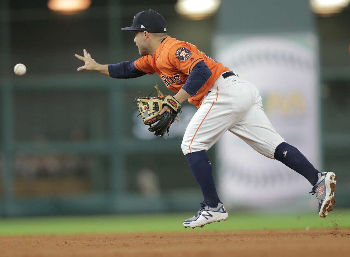 Houston Astros second baseman Jose Altuve (27) tosses the ball for a double play in the eighth inning. Houston Astros host the Oakland Athletics at Minute Maid Park on Friday, Aug. 18, 2017, in Houston. ( Elizabeth Conley / Houston Chronicle )