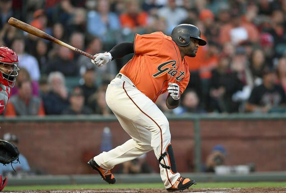 Pablo Sandoval hits a scoring single in the first inning for his second RBI back with the Giants. His first came on a home run in Washington. Photo: Thearon W. Henderson, Getty Images