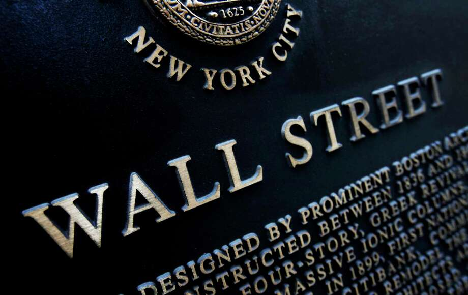 FILE - This Jan. 4, 2010, file photo shows an historic marker on Wall Street in New York. U.S. stocks continued to skid early Friday, Aug. 18, 2017, as industrial companies fell after a weak report from farm equipment giant Deere. (AP Photo/Mark Lennihan, File) Photo: Mark Lennihan, STF / Copyright 2016 The Associated Press. All rights reserved. This material may not be published, broadcast, rewritten or redistribu