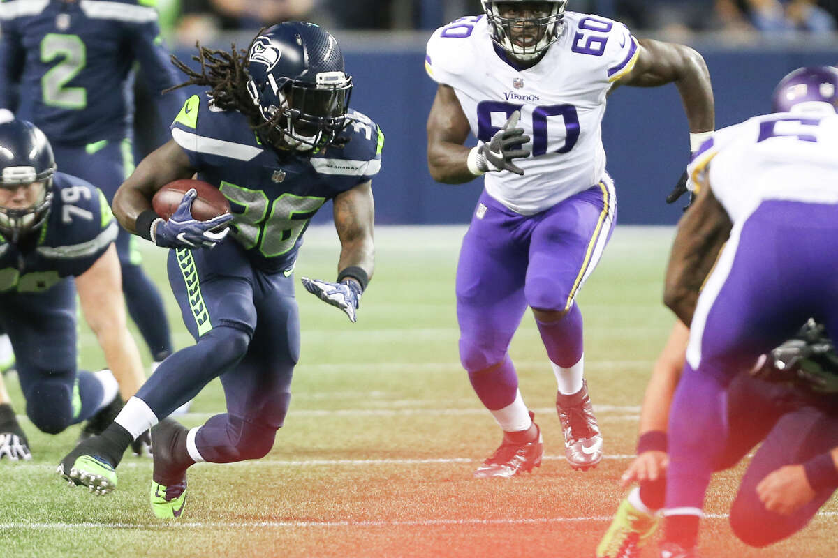 Seahawks running back Alex Collins runs the ball in the second half of a preseason game against the Vikings at CenturyLink Field on Friday, Aug. 18, 2017.