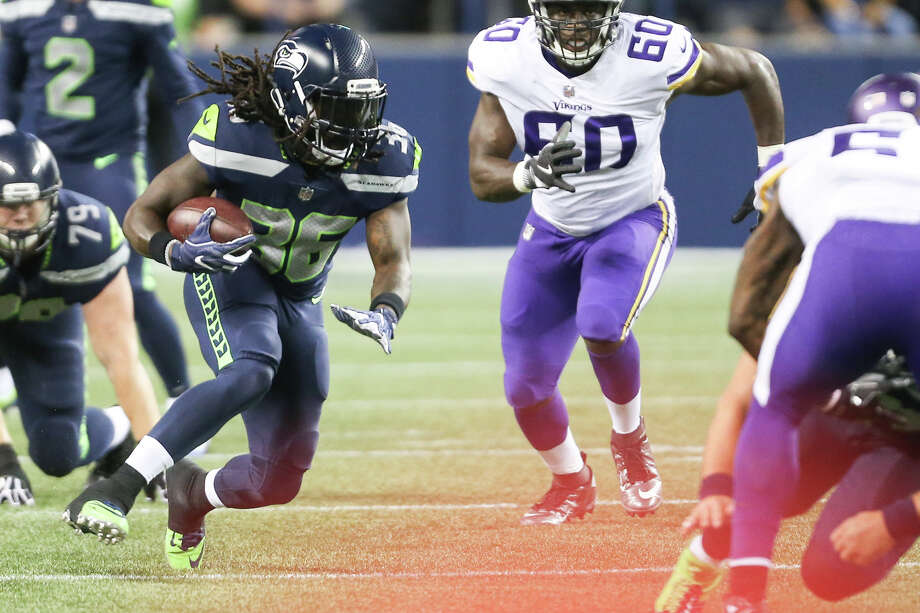 cb0f7086f Seahawks running back Alex Collins runs the ball in the second half of a  preseason game