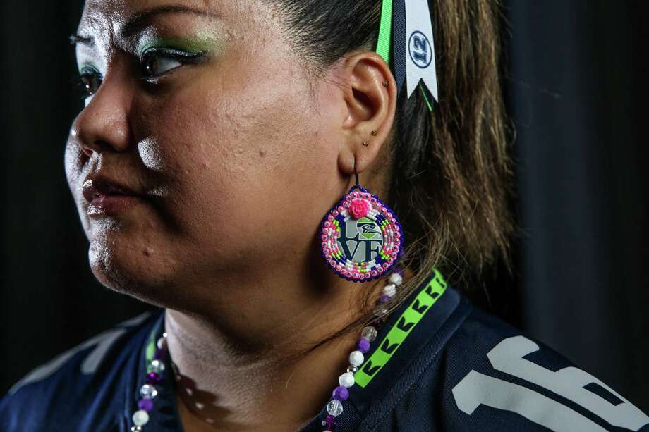 Adrienne Fulgencio poses for a portrait before a Seahawks game at CenturyLink Field, Aug. 18, 2017. Photo: GENNA MARTIN, GENNA MARTIN, SEATTLEPI.COM / SEATTLEPI.COM