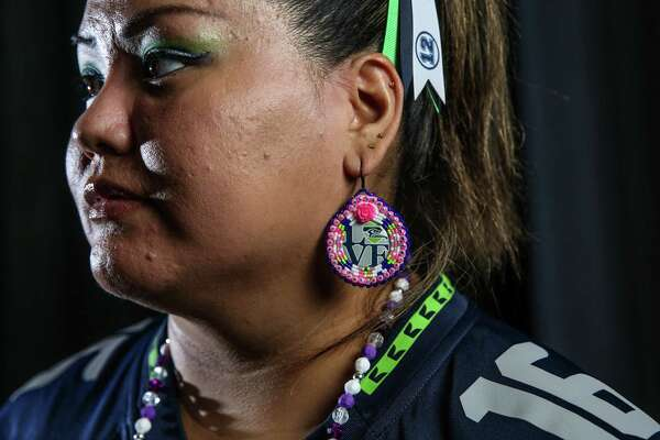 Adrienne Fulgencio poses for a portrait before a Seahawks game at CenturyLink Field, Aug. 18, 2017.