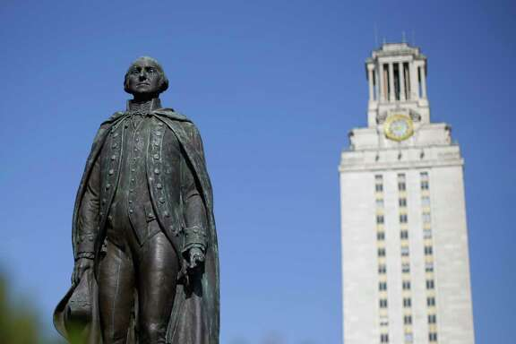 A statue of George Washington stands near the University of Texas Tower  at the center of campus.