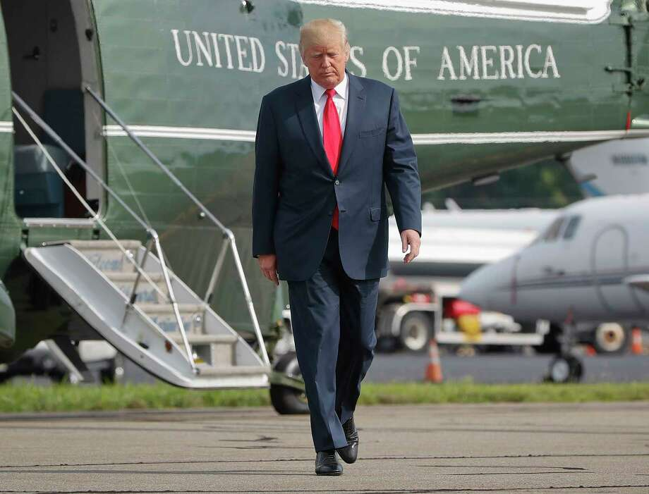 President Donald Trump walks across the tarmac from Marine One to board Air Force One last week at Morristown Municipal Airport in Morristown, N.J. (AP Photo/Pablo Martinez Monsivais, File) Photo: Pablo Martinez Monsivais, STF / Internal