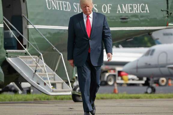 President Donald Trump walks across the tarmac from Marine One to board Air Force One last week at Morristown Municipal Airport in Morristown, N.J. (AP Photo/Pablo Martinez Monsivais, File)