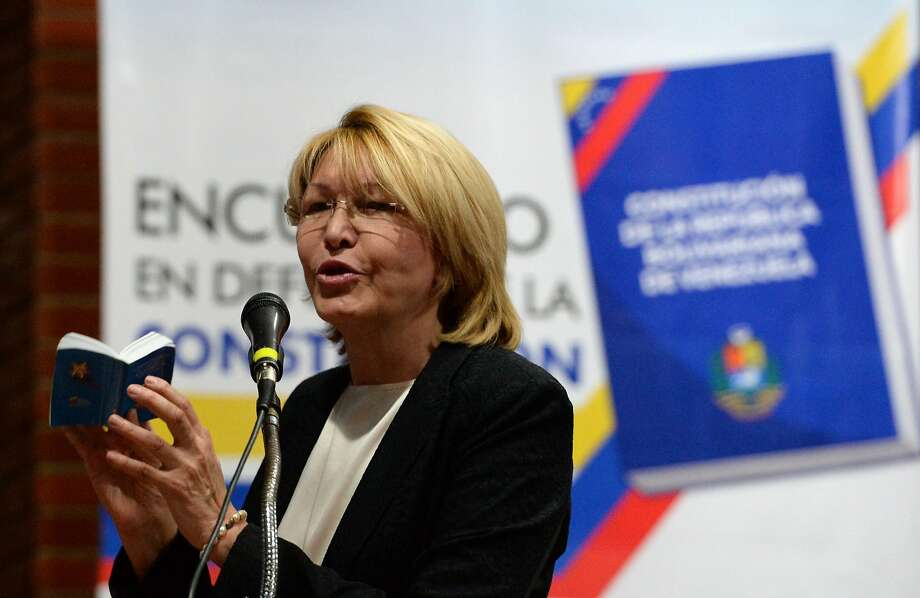 Venezuela's former chief prosecutor, Luisa Ortega Diaz, shown during a democracy forum, and husband German Ferrer arrived Friday in Bogota aboard a private plane traveling from Aruba. Photo: FEDERICO PARRA, AFP/Getty Images