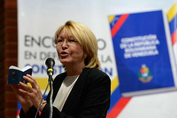"""(FILES) This file photo taken on August 06, 2017 shows Venezuela's dismissed chief prosecutor Luisa Ortega, one of President Nicolas Maduro's most vocal critics, speaking during the """"In Defence of Democracy Forum"""" held by the opposition in Caracas, a day after a new assembly with supreme powers and loyal to President Nicolas Maduro started functioning and fired her. Venezuela's sacked attorney general Luisa Ortega arrived on August 18, 2017 to Colombia after abbandoning her country where she has faced growing harassment, after security forces have raided her home and the authorities have issued an arrest warrant for her husband, a lawmaker who also broke with Maduro. / AFP PHOTO / Federico PARRAFEDERICO PARRA/AFP/Getty Images"""