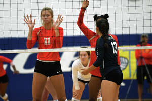 Cy Woods senior middle blocker Cate Reese (11) puts her game face on as she works at the net against Cy Ridge during their match on day three of the John Turner Classic at Katy Taylor High School on Aug. 12, 2017. (Photo by Jerry Baker)