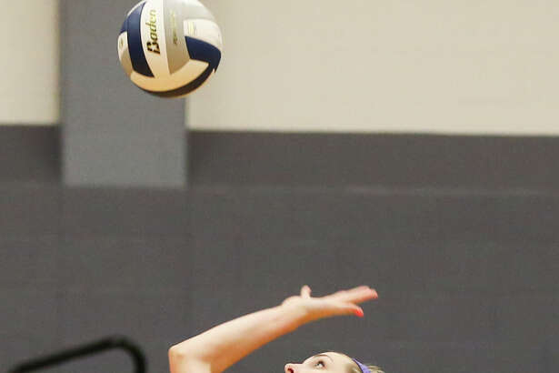 College Park's Audrey Penn (11) hits the ball during the high school volleyball game against The Woodlands on Friday, Sept. 18, 2015, at College Park High School.