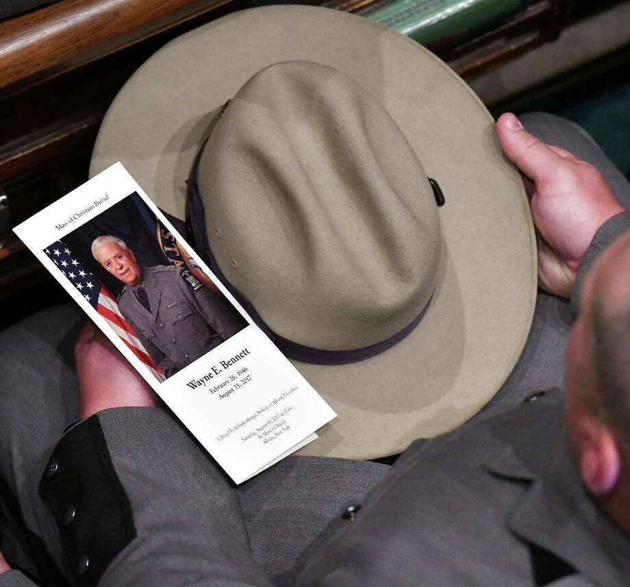 A NYS Trooper holds a mass card and his Stetson during  funeral services for former NYSP Superintendent and Schenectady public safety commissioner Wayne Bennett at St. Mary's Church Saturday August 19, 2017 in Albany, NY.  (John Carl D'Annibale / Times Union) Photo: John Carl D'Annibale / 20041309A
