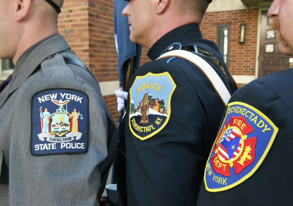 FILE - Members of the NYS Police, Schenectady Police and Fire Departments stand together Saturday August 19, 2017 in Albany, NY. (John Carl D'Annibale / Times Union)
