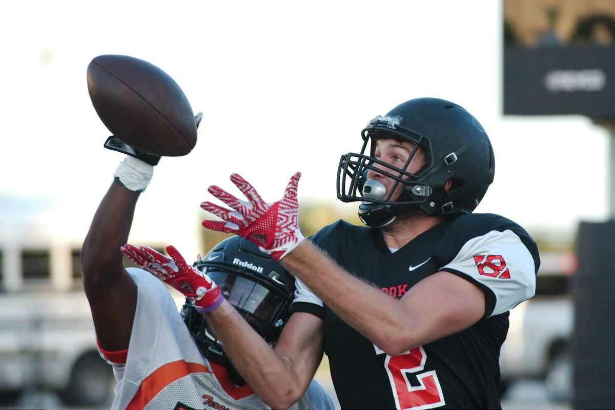 Clear Brook's Caleb Chapman (2) tries to pull down a pass during a pre-season scrimmage against Texas City Friday, Aug. 18.