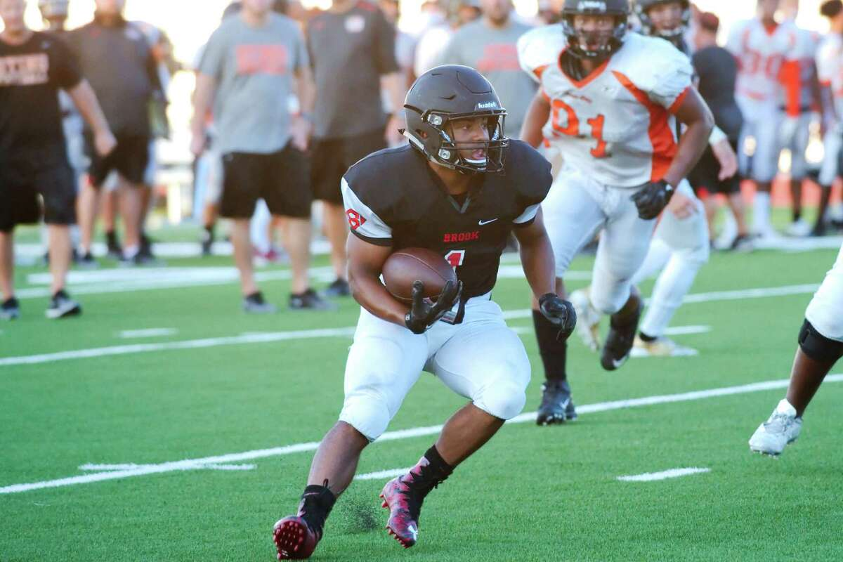Clear Brook's Jarrett Smith (1) finds running room against Texas City during a pre-season scrimmage Friday, Aug. 18.