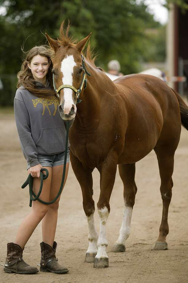 Leigha Martyn of Sanford, 17, poses for a portrait with her horse, Autumn, on Friday, August 18, 2017 at the Fairgrounds. Photo: (Katy Kildee/kkildee@mdn.net)