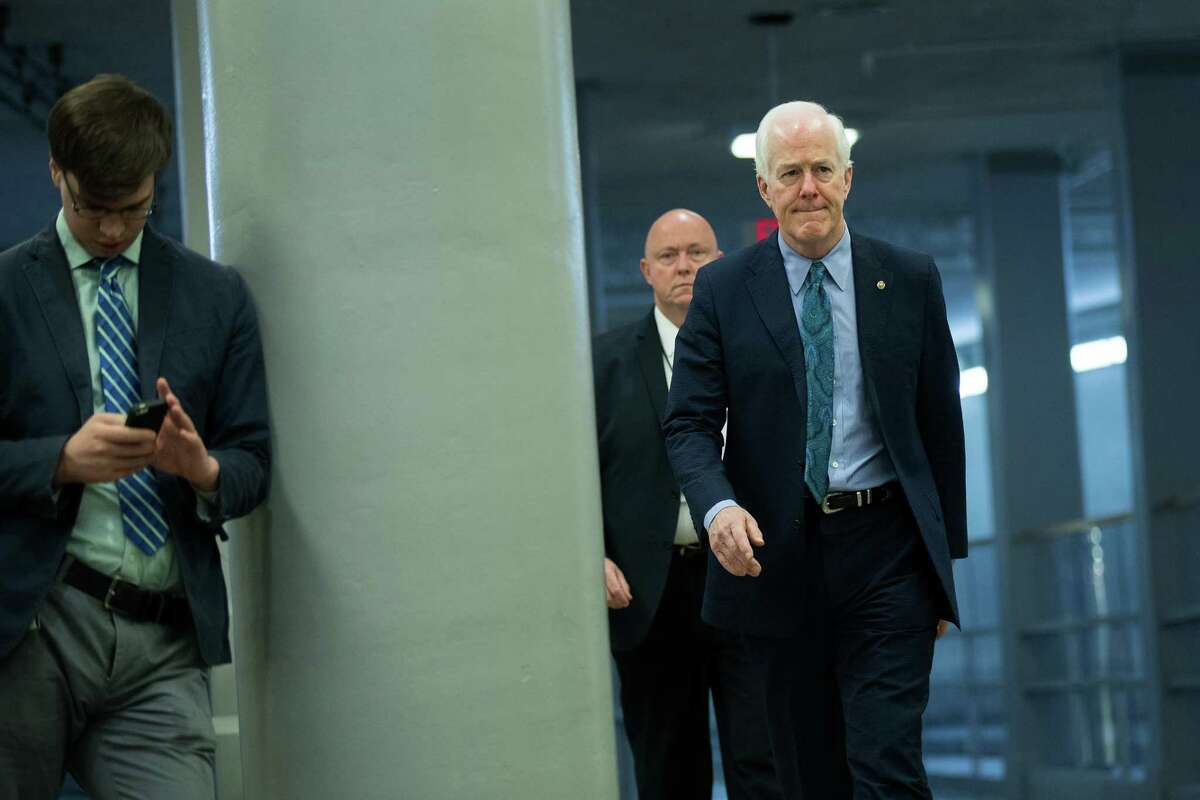 WASHINGTON, DC - JULY 27: Sen. John Cornyn (R-TX) walks through the Senate subway on his way to an amendment vote on the GOP heath care legislation on Capitol Hill, July 27, 2017 in Washington, DC. Senate Republicans are working to pass a stripped-down, or 'Skinny Repeal,' version of Obamacare reform that might include repealing individual and employer mandates and tax on medical devices. (Photo by Drew Angerer/Getty Images)