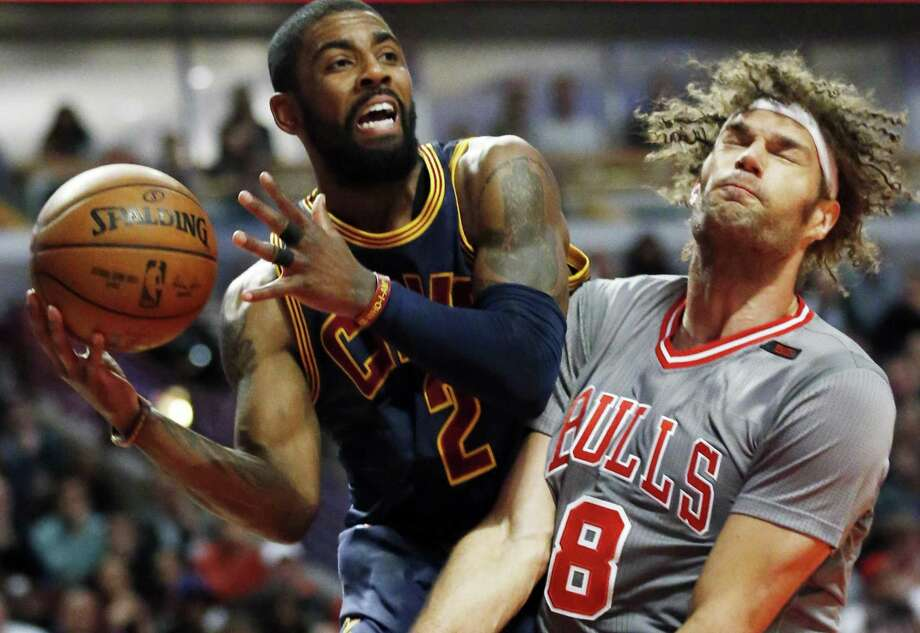 Cleveland Cavaliers guard Kyrie Irving looks to pass against Chicago Bulls center Robin Lopez during the first half on March 30, 2017, in Chicago. Photo: Nam Y. Huh /Associated Press / Copyright 2017 The Associated Press. All rights reserved.