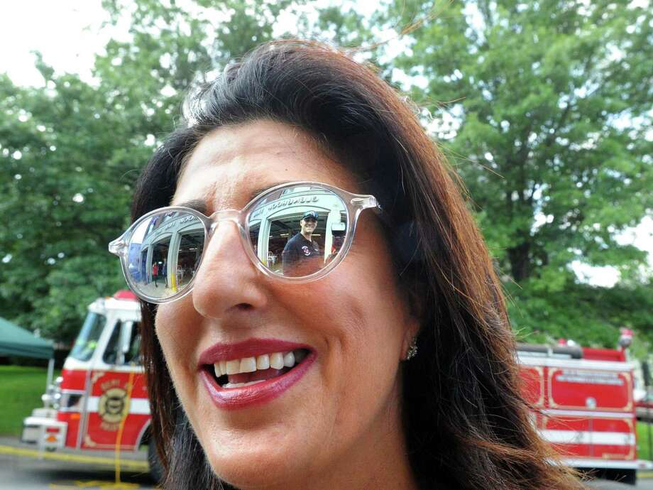 Glenbrook Fire Department Lt. Reema Odeh smiles as she speaks with fellow Glenbrook firefighter Sean Grogan (reflected in her sunglasses) during the Glenbrook Fire Department's 100th anniversary celebration at the station in the Glenbrook section of Stamford. Conn., Saturday, Aug. 19, 2017. Photo: Bob Luckey Jr. / Hearst Connecticut Media / Greenwich Time