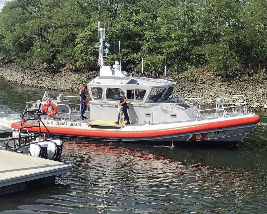 Rescue units, including the USCG, responded to the area of Penfield Reef in Fairfield, Conn., on Saturday, to search for two missing fishermen. The search began around 8 a.m. and switched to recovery mode around 2 p.m. Photo: Tara O'Neill / Hearst Connecticut Media / Connecticut Post