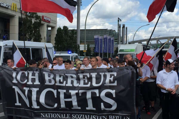 "Neo-Nazis rallied in Berlin on Saturday, one week after a protest in Virginia turned deadly. A banner, which read ""I regret nothing,"" announced the message of the march."
