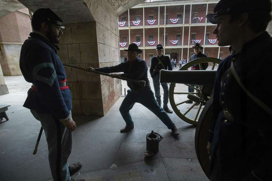 Re-enactors dressed in Union blue uniforms demonstrate how to fire a cannon during Civil War Living History Day at Fort Point in San Francisco. Photo: Paul Kuroda / Photos By Paul Kuroda / Special To The Chronicle / online_yes