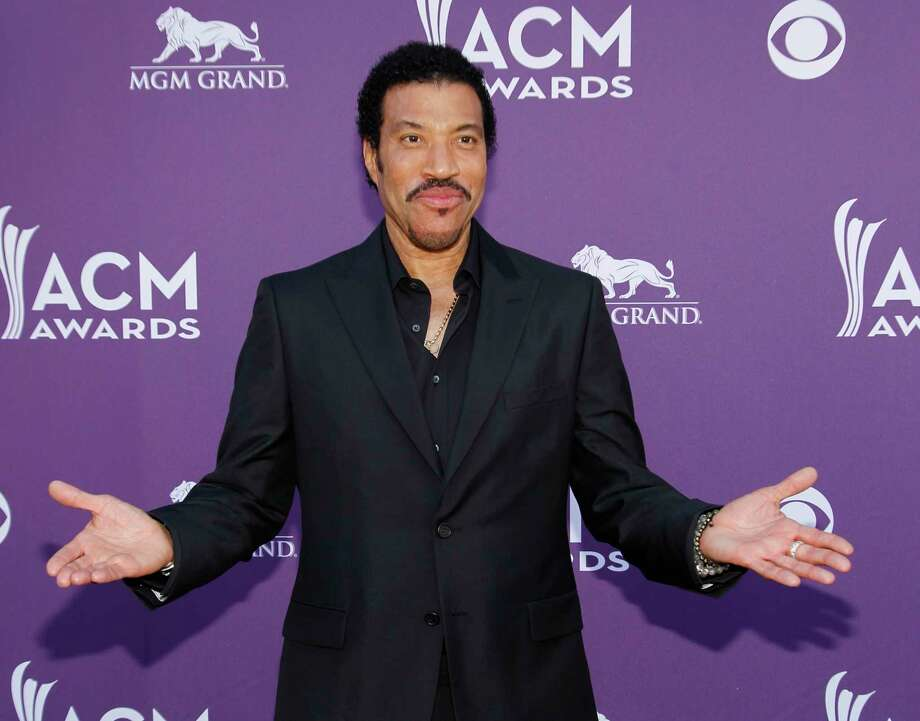 FILE - In this photo taken April 1, 2012, Lionel Richie arrives at the 47th Annual Academy of Country Music Awards in Las Vegas. The John F. Kennedy Center for the Performing Arts announced the recipients of the 2017 Kennedy Center Honors. They are: hip-hop artist LL Cool J, singers Gloria Estefan and Lionel Richie, television writer and producer Norman Lear and dancer Carmen de Lavallade. It's the 40th year of the awards, which honor people who have influenced American culture through the arts.  (AP Photo/Isaac Brekken, File) Photo: Isaac Brekken, FRE / FR159466 AP
