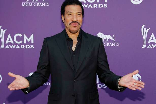 FILE - In this photo taken April 1, 2012, Lionel Richie arrives at the 47th Annual Academy of Country Music Awards in Las Vegas. The John F. Kennedy Center for the Performing Arts announced the recipients of the 2017 Kennedy Center Honors. They are: hip-hop artist LL Cool J, singers Gloria Estefan and Lionel Richie, television writer and producer Norman Lear and dancer Carmen de Lavallade. ItÂ?'s the 40th year of the awards, which honor people who have influenced American culture through the arts. (AP Photo/Isaac Brekken, File)