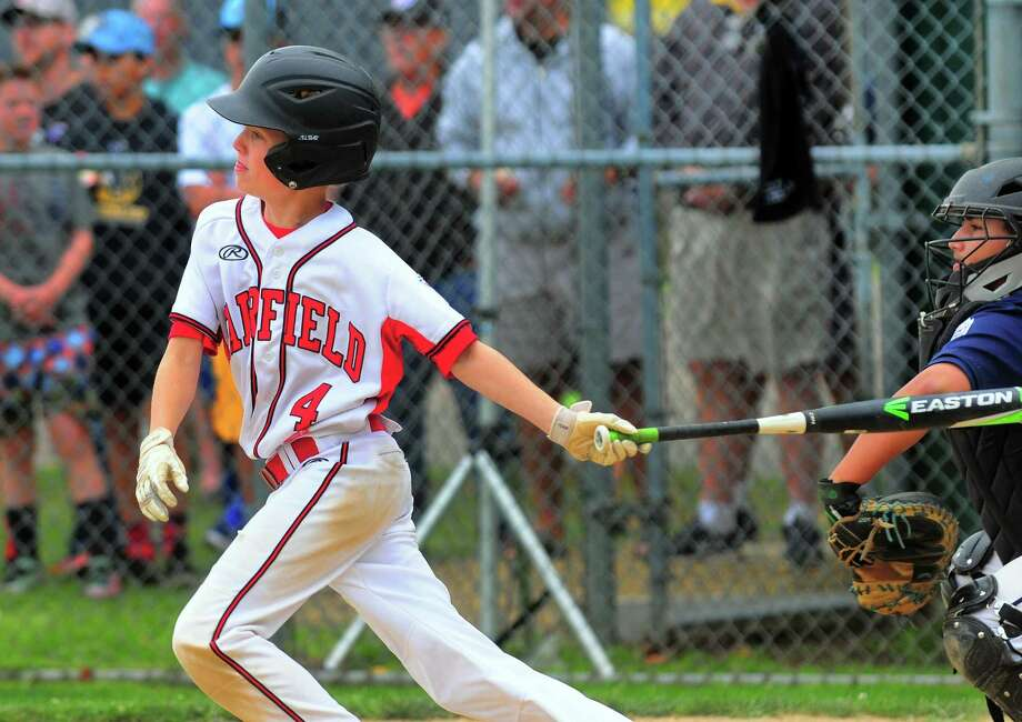 Fairfield American's Owen Kalagher watches his game winning double in the bottom of the sixth in a 5-4 win over Newington in the State tournament. Photo: Christian Abraham / Hearst Connecticut Media / Connecticut Post