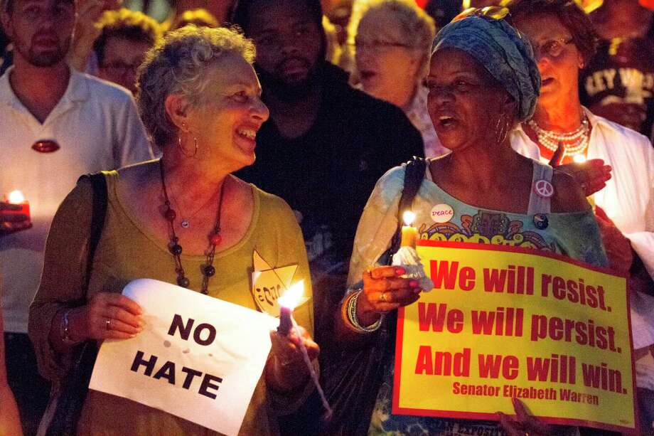 "Kerry Rosen, left and Lala Archie sing ""This Little Light of Mine"" in Savannah, Ga., at Savannah Taking Action for Resistance's candlelight vigil for the victims of Charlottesville, Va. The vigil took place a day after a white supremacist rally spiraled into deadly violence in Charlottesville. Photo: Will Peebles, MBI / Savannah Morning News"