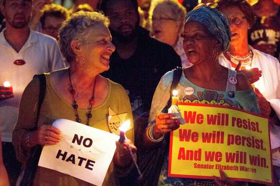 "Kerry Rosen, left and Lala Archie sing ""This Little Light of Mine"" in Savannah, Ga., at Savannah Taking Action for Resistance's candlelight vigil for the victims of Charlottesville, Va. The vigil took place a day after a white supremacist rally spiraled into deadly violence in Charlottesville."