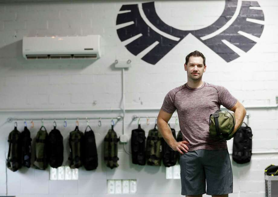 Aaron Holmes in his new fitness studio, specializing in adventure and core training, at Method & Crew. The concept is centered around building core stability and training your body to move more efficiently where it counts the most - life outside the gym. Wednesday, Aug. 2, 2017, in Houston. ( Karen Warren / Houston Chronicle ) Photo: Karen Warren, Staff Photographer / @ 2017 Houston Chronicle