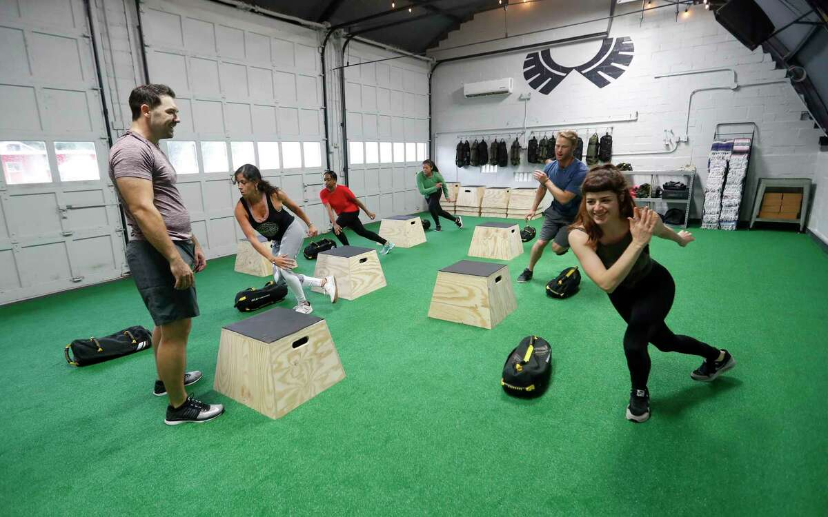 Aaron Holmes works with clients in his new fitness studio, specializing in adventure and core training, at Method & Crew. The concept is centered around building core stability and training your body to move more efficiently where it counts the most - life outside the gym. Wednesday, Aug. 2, 2017, in Houston. ( Karen Warren / Houston Chronicle )