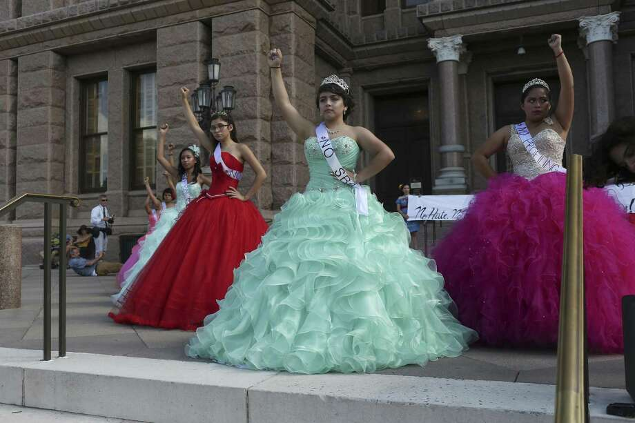 "Dressed as a Quice–eras, young women protest SB4 in front of the State Capitol, Wednesday, July 19, 2017. The bill known as the ""show me your papers,"" bill will take effect on September 1st. The Quince–era is the coming of age for a girl in the Hispanic culture. Photo: Jerry Lara, Staff / San Antonio Express-News / San Antonio Express-News"