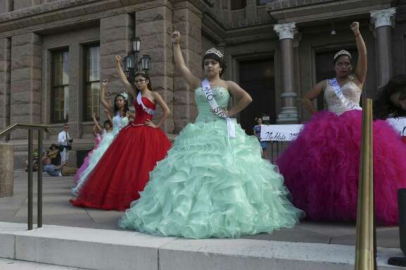 "Dressed as a Quice–eras, young women protest SB4 in front of the State Capitol, Wednesday, July 19, 2017. The bill known as the ""show me your papers,"" bill will take effect on September 1st. The Quince–era is the coming of age for a girl in the Hispanic culture."