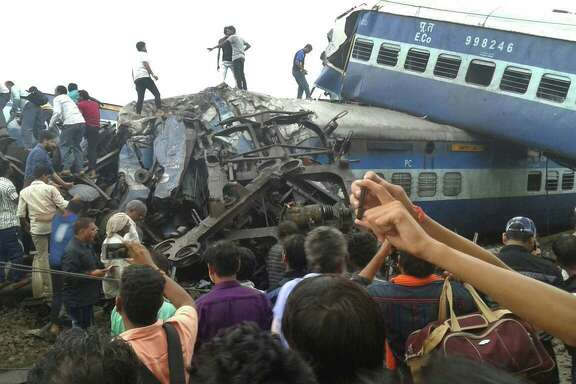 Police and volunteers look for survivors Saturday after a train accident near Khatauli, in the northern Indian state of Uttar Pradesh. Six coaches derailed, killing more than 20 people and injuring dozens.