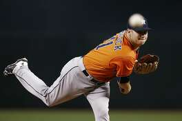 Houston Astros' Brad Peacock warms up during the first inning of a baseball game against the Arizona Diamondbacks Tuesday, Aug. 15, 2017, in Phoenix. The Astros defeated the Diamondbacks 9-4. (AP Photo/Ross D. Franklin)