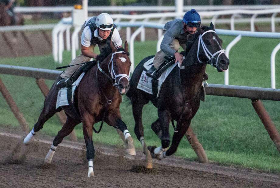 Travers Stakes contender Girvin with regular jockey Robby Albarado in the saddle, right works in company with trainer Joe Sharpe riding Line judge, left before daybreak Saturday Aug. 19, 2017 on the Oklahoma Training Center track in Saratoga Springs, N.Y.  (Skip Dickstein/Times Union) Photo: SKIP DICKSTEIN