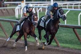 Travers Stakes contender Girvin with regular jockey Robby Albarado in the saddle, right works in company with trainer Joe Sharpe riding Line judge, left before daybreak Saturday Aug. 19, 2017 on the Oklahoma Training Center track in Saratoga Springs, N.Y.  (Skip Dickstein/Times Union)