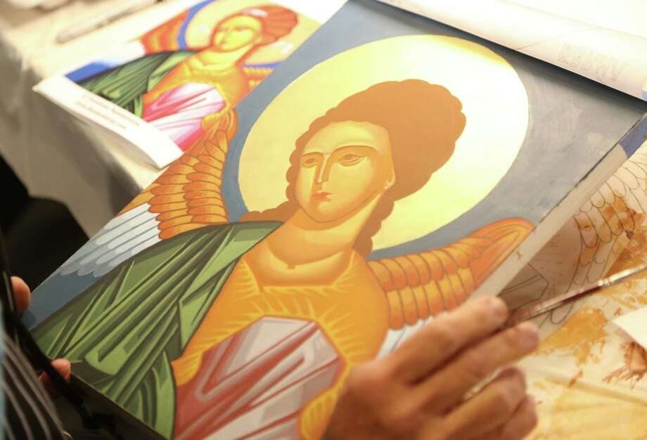 Mary Grassel works on her icon of St. Michael at the Catholic Diocese's Spiritual Life Center in Wichita, Kan. Photo: Bo Rader / handout
