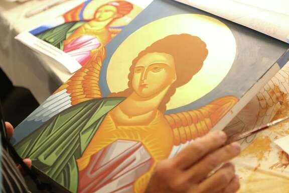 Mary Grassel works on her icon of St. Michael at the Catholic Diocese's Spiritual Life Center in Wichita, Kan.