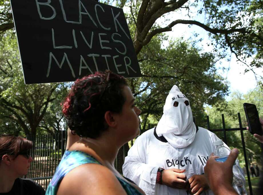 """Big Texas"" dressed up to participate the Black Lives Matter protest against Spirit of the Confederacy statue at Sam Houston Park Saturday, Aug. 19, 2017, in Houston. Photo: Yi-Chin Lee, Houston Chronicle / © 2017  Houston Chronicle"