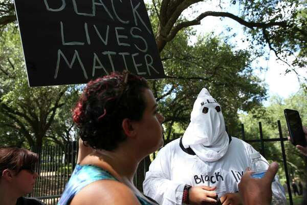"""Big Texas"" dressed up to participate the Black Lives Matter protest against Spirit of the Confederacy statue at Sam Houston Park Saturday, Aug. 19, 2017, in Houston."